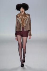 Ash shearling cropped trench with champagne chiffon shirt & aubergine leather shorts.